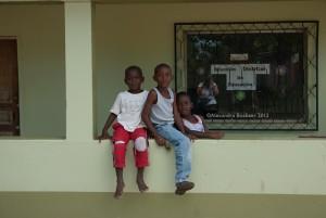 Tourist photographing local children, Honduras